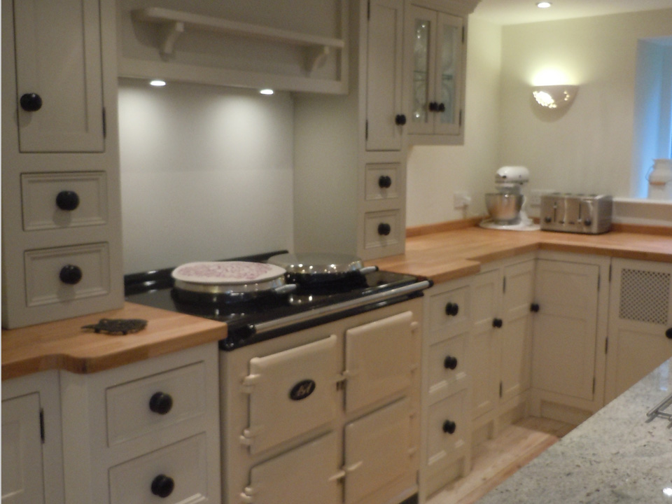 Cream Coloured Units Wooden With Integrated Aga Cooker