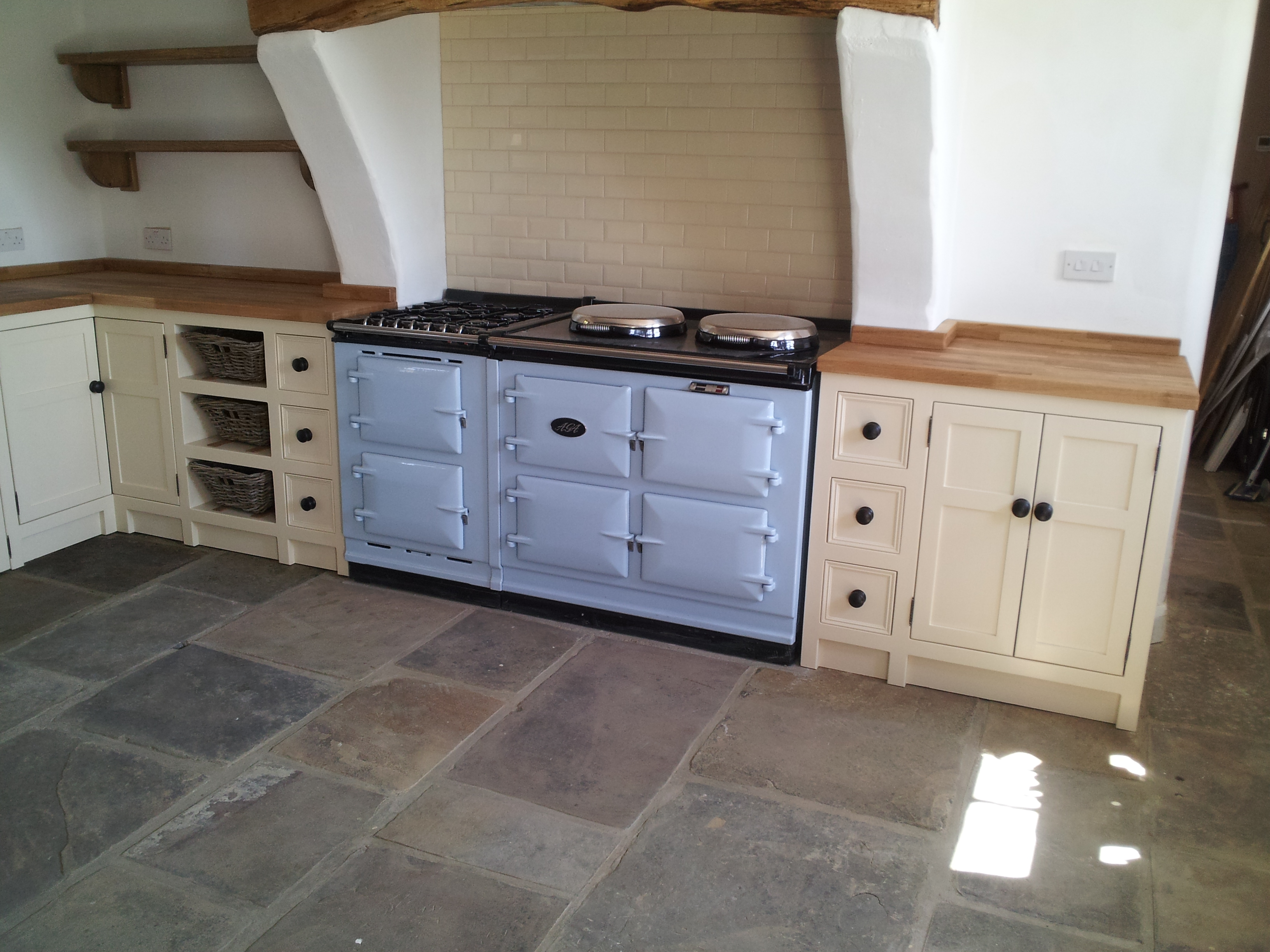 Dacre banks large kitchen with matching coloured aga and for Cream kitchen base units
