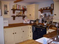 Dawn's Kitchen with Cream Wall Units and Integrated Aga Stove