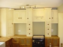 Maurice and Zara's Oak kitchen units and Cream Wall Units