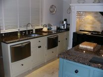 Cream and Blue contemporary Kitchen with Integrated Appliances
