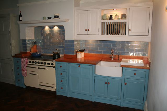 Full Kitchen With Freestanding Units Integrated Belfast Sink Aga Stove And Large Cream Larder