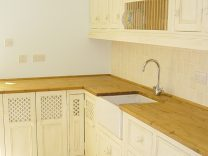 A 'Shabby Chic' Kitchen with Belfast Sink, integrated plate rack