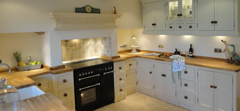 Kitchen With White Cabinets Wood Worktops Glass Doors And Integrated